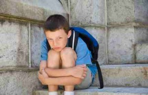 Boy on School Steps